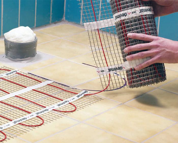 Как своими руками сделать теплый пол под ламинат